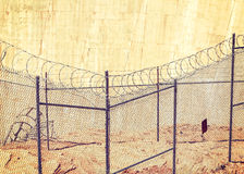 Barbed wire fence, crime and punishment concept. Stock Image