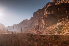 Barbed wire fence in desert Royalty Free Stock Photos