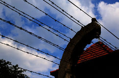 Barbed wire fence in a European prison camp Stock Images