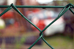 Barbed wire. Fence with barbed wire in front of factory Stock Image