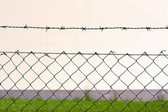 Barbed wire fence. In front of the factory Royalty Free Stock Image