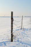 Barbed wire fence and frozen Gulf of Finland Stock Photography