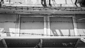 Barbed wire fence lack and white shot Royalty Free Stock Photo