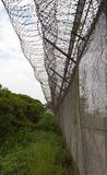 Barbed wire fence. Mai Po. Hong Kong. Royalty Free Stock Photography