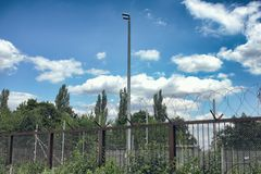 Barbed Wire fence nuclear power station old out of order germany nature tower sky plant rust industry out of order royalty free stock photos