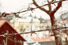 Barbed wire fence in old town Banska Stiavnica, Slovak republic, Royalty Free Stock Photos