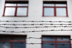 Barbed wire and fence at the prison Stock Photos