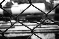Barbed Wire Fence. Prison Fence in Black and White Closeup. Royalty Free Stock Images