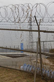 Barbed wire fence separates South from North Korea - prayer wishes tied to fence - Asia- NOVEMBER 2013 Royalty Free Stock Photos
