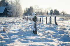 Barbed wire fence with snow covered ground Stock Image