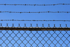 Barbed wire fence top Royalty Free Stock Image