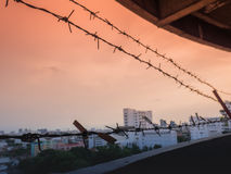 Barbed wire fence with Twilight sky to feel Silent and lonely and want freedom.  Royalty Free Stock Photo