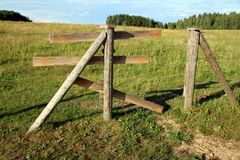 Barbed wire fence. Wooden fence post with barbed wire surrounding stock photography
