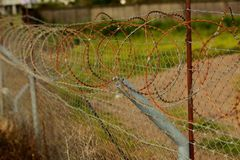 Barbed wire fenced territory airport royalty free stock image