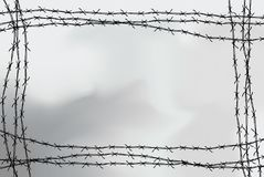 Barbed wire fencing. Fence made of wire with spikes. Black and white illustration to the holocaust. Console camp. Barbed wire fencing. Fence made of wire with stock illustration