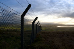 Barbed wire fencing and scenic view Stock Image