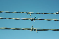 Barbed. Wire Fencing, sky as background Royalty Free Stock Images