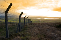 Barbed wire fencing and view Royalty Free Stock Photography