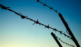 Barbed Wire. In front of a dark blue sky royalty free stock photos