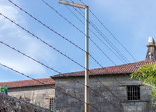 Barbed wire in front of the prison building. Image of barbed wire in front of the prison building stock photography