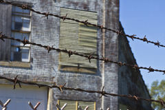 Barbed Wire Guarding an Abandoned Factory Stock Photography