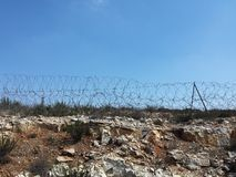 Barbed wire on hill, sign of occupied Palestine Royalty Free Stock Photos