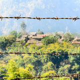 Barbed Wire and House of Refugee Camps Royalty Free Stock Photo