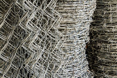 Barbed wire and iron net roll Royalty Free Stock Photography