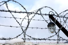 Barbed wire and lamp. Protection of the guarded territory Stock Photography