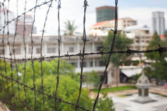 Barbed wire in memorial prison museum building in Cambodia close. To Phnom Penh Pol Pot Holocaust stock photo