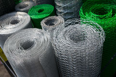 Barbed wire and mesh netting rolls Stock Photography