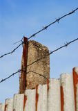 Barbed wire on the metal wall Royalty Free Stock Image