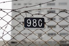 Barbed Wire With Number Plate Stock Images