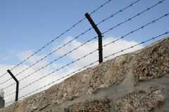 Barbed wire over the stone wall Royalty Free Stock Photography