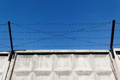 Barbed wire over wall Stock Image