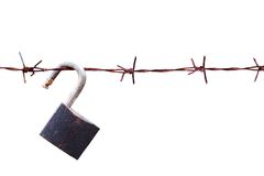 Barbed wire with padlock Royalty Free Stock Photos