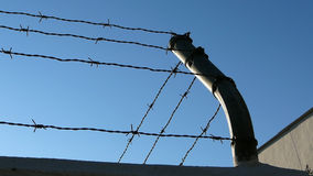 Barbed Wire and pole Stock Photos