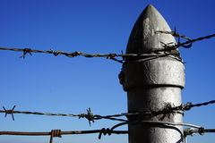 Barbed wire and power Royalty Free Stock Photo