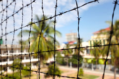Barbed wire at the prison complex in Asia Royalty Free Stock Image