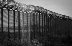 Barbed wire - restricted area, beacon of hope. Black and white p Royalty Free Stock Photo