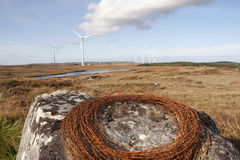 Barbed wire on a rock with wind turbines Royalty Free Stock Photography