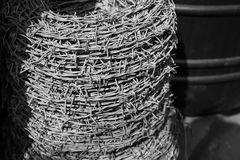 Barbed wire roll on black background Stock Photos