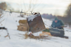 Barbed wire with a rusty can of alarm on the position of the soldiers of the third Reich Stock Image
