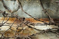 Barbed wire rusty metal wall background Stock Image