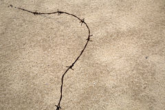 Barbed wire  on sand Stock Photos
