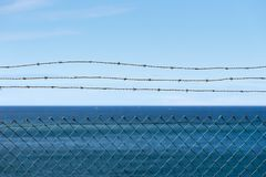 Barbed wire with sea view stock image