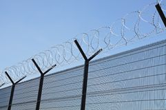 Barbed wire security fence. Royalty Free Stock Photo