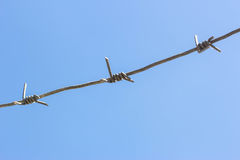 Barbed wire in the sky Stock Image