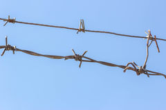 Barbed wire in the sky Stock Photography