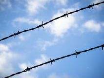Barbed wire in the sky Stock Photos